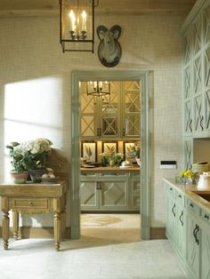 Mirrored cabinet doors, awesome idea to open the space without the clutter-showing glass.I could do that in my kitchen without replacing the cabinet doors. Luxury Interior Design, Interior Exterior, Kitchen Interior, Kitchen Cabinet Shelves, Kitchen Cabinets, Green Cabinets, Kitchen Pantry, Colored Cabinets, Organized Kitchen
