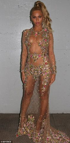 Nearly naked: Like Kim, Beyonce wore a nude-effect gown, but hers was completely sheer wit...