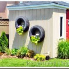 Hanging tire planters : ) Love! Just spray paint bright colors for even more fun. Would be great on a fence or the side of a shed.