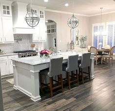 White Kitchen with grey-stained hardwood floors White Kitchen with grey-stained . - White Kitchen with grey-stained hardwood floors White Kitchen with grey-stained hardwood floor idea - Grey Kitchen Walls, Grey Kitchen Island, Kitchen Island With Seating, Grey Kitchens, Kitchen Flooring, Cool Kitchens, Kitchen Cabinets, Kitchen Islands, Kitchen White
