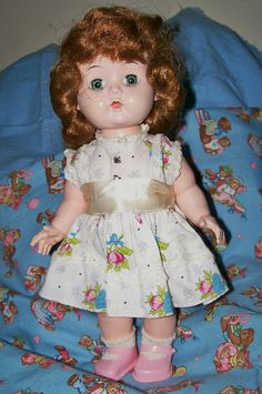 """The sweet little block doll I purchased at the doll show in Valparaiso, IN. I believe she is Karen the answer doll. She has a button on her back that makes her nod """"yes"""" and one on her tummy that mmakes her shake her head """"no. She is so cute!"""
