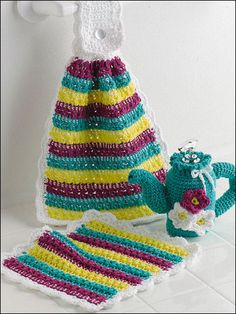 "Teapot Kitchen Set - Crochet a pretty teapot soap cover with coordinating dishcloth and towel for your kitchen. Size: Dishcloth: 9 1/2"" x 10"". Towel: approx 13"" x 15"". Soap Cover: fits 7- 1/2 fl. oz. soap dispenser. Skill Level: Intermediate Designed by Adapted from Various Designers free pdf from freepatterns.com (this is different)"