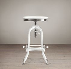 RH's Vintage Toledo Barstool:Our perfect reproduction of the classic vintage-inspired draftsman's chair pairs industrial styling with the warmth of wood seating in both stained and painted finishes.