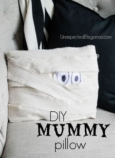 This is a fun and EASY Halloween craft decor idea.  Get a tutorial for a DIY Mummy Pillow! Love this Halloween Decor