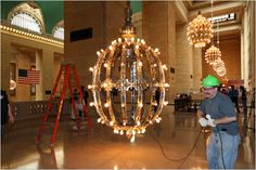 Cleaning the chandeliers at Grand Central