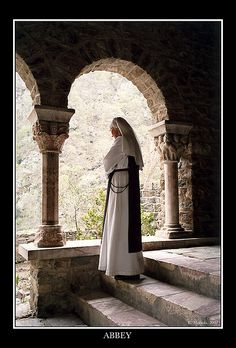 A nun in the cloister of Canigou, Roussillon, France