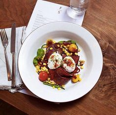 #FarmshopLA Make brunch better with the House Made Pastrami and Poached Eggs served with padron peppers, blistered tomatoes, brentwood sweet corn and pickled shallots. / Photo credit: Kylie Mazon