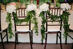 Head Table chair decoration with peony and garland of greenery draped over the chairs. So chic and romantic! Venue: willowdaleestate.com