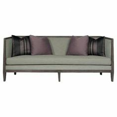 """Made in the USA, this midcentury-inspired sofa showcases a sleek silhouette and features 4 down-filled toss pillows for a cozy touch.  Product: SofaConstruction Material: Wood, rayon, polyester and foamColor: PortobelloFeatures:  Made in the USAFour accent pillows includedDimensions: 32.5"""" H x 82"""" W x 34"""" D"""