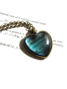 Neptune  Heart Necklace  24 inch on antique by DarkMatterJewelry, $18.00
