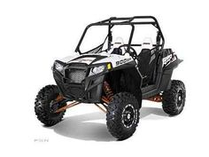 """Used 2012 Polaris Ranger RZR XP 900 White Lightning LE ATVs For Sale in Michigan. 2012 Polaris Ranger RZR XP 900 White Lightning LE, Very clean !! - Same Razor Sharp Performance Features as the Base Model Plus: Maxxis Bighorn tires on 12 in. Black Bruiser aluminum rims White Lightning dash with black painted hood Custom two color cut & sew black and white seats with red RZR emblem Custom """"Xtreme"""" graphics package"""