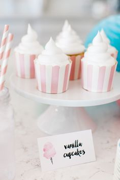 The TomKat Studio | Kate's Cotton Candy Party - Vanilla Cupcakes baked in our Striped Baking Cups topped with Whipped Cream Frosting! Find the baking cups here: http://www.thetomkatstudio.com/shop/baking-cups