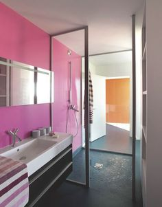 Colorful family house designed by Matali Crasset, – Laundry Room Modern White Bathroom, Eclectic Bathroom, Bathroom Styling, Bathroom Lighting, Pink Accent Walls, Vintage Bathtub, Pink Vanity, Pink Tiles, Blue Floor