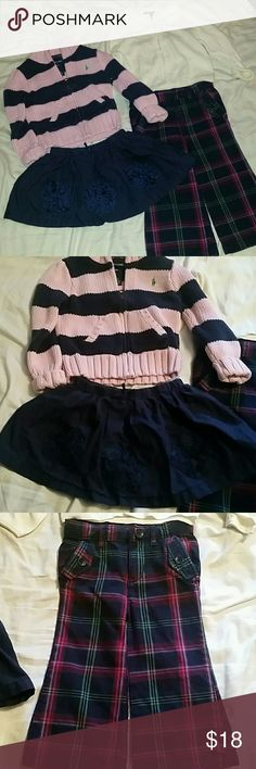 Lot of 18-24m girls ralph lauren, baby gap 4 pieces of 18-24 month girls clothes. Baby Gap plaid boot cut pants and white/cream sweater 18-24 months. Ralph Lauren pink and blue striped zip up sweater 18 months. Osh kosh B Gosh navy blue flower ribbon skirt 18 months. Really cute and good condition. Ralph Lauren Matching Sets