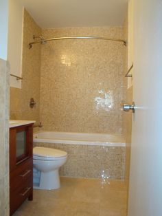 tile + curves shower curtain rod... would love to see the bathroom decor they ended up using!