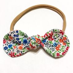 Handmade cotton knot bow Measures 4 You can have the bow attached to a clip or one size fits all nylon elastic.