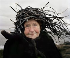 """""""Eyes as Big as Plates"""" is a whimsical series by Finnish photographer Riitta Ikonen and Norwegian photographer Karoline Hjorth that features senior citizens donning organic materials like twigs and grass."""