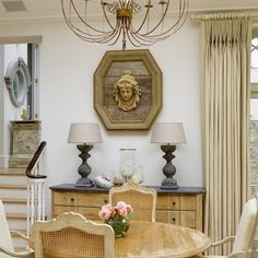 """""""Restored Victorian home, this is the dining area adjoining the kitchen, Belgian oak sideboard with Ralph Lauren linen curtains. Spot the duck…"""""""