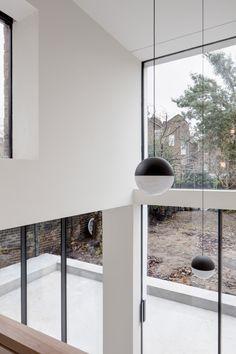 APA creates warehouse-inspired interior for refurbished London townhouse.