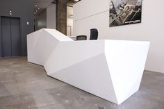 STUDIOS Architecture contacted C.W. Keller to engineer and fabricate a striking reception desk. The faceted solid surface desk presented it's own unique challenges in that it needed to be in four individual parts and assembled in the field