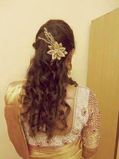 Indian bride's bridal reception hairstyle by Swank Studio. #Saree #Blouse #Design #HairAccessory #curls #statementblouse Tamil bride. Telugu bride. Kannada bride. Hindu bride. Malayalee bride. Find us at https://www.facebook.com/SwankStudioBangalore