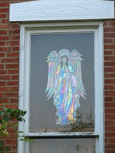 stained glass angel. Have 2 large angel patterns  I need to tackle sometime.