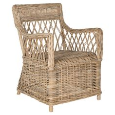 Bring natural appeal to your home library or living room with this rattan arm chair, showcasing an openwork back and skirted silhouette.