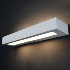 Tornado TR9055 Linear Plaster Wall Light  single 55w dimmable fluorescent or LED. Up down light for high localised light levels. Crisp, clean, minimalist lines. Manufactured by Tornado Lighting & Design Ltd, London