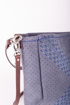 Medium sized hand bag, visible hand sewn hem and beautiful light and dark blue embroidery. It is made from a thick, soft full grain in a beautiful shade of light blue perforated leather. It comes unlined with a double detachable shoulder and cross body leather strap and a magnetic button closure.  27.5 cm tall, 38 cm wide and 11 cm deep. Height: 27.5 cm/ 11 inch  Width: 38 cm / 15 inch Deep: 11 cm/ 4.3 inch  Handle drop: 60 cm/ 23.6 inch Strap: 100 cm / 39.4 inch Shades Of Light Blue, Light In The Dark, Dark Blue, Beautiful Lights, Hand Sewn, Cross Body, Louis Vuitton Damier, Things To Come, Handbags