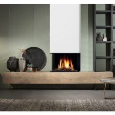 Three, Fire in fireplace, best price on Warmtestore Your Haardenspecialist Warmtestore. Fireplace Feature Wall, Fireplace Built Ins, Fireplace Hearth, Home Fireplace, Modern Fireplace, Living Room With Fireplace, Fireplace Design, Home Wall Colour, Espace Design