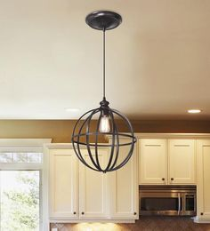 "Edison bulb globe bronze pendant. 10"" diameter. Home Decorators. To hang from the bedroom ceiling, it will cast interesting shadows."