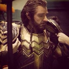 Richard Armitage as Thorin.  Behind the scenes suiting up in armor.