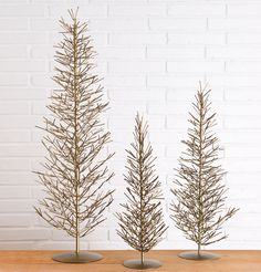 Noticing a trend with Rustic Luxe to MORE COLOR- Antique Brass Wire Evergreens - Magnolia Marke