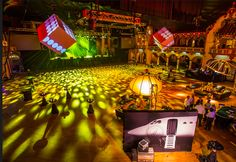"""Last year, Groupon hosted a """"007""""-theme holiday party at the Aragon Ballroom in Chicago. Event Creative decked the venue with James Bond-inspired decor."""