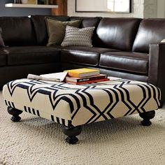 Ottoman would make a great coffee table- nice way to bring a fun pattern into a room.