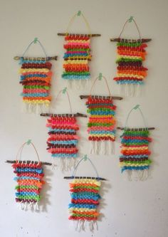 Kids dye their own chunky wool yarn with Koolaid, then make small weaving on cardboard looms.