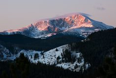 pink rays of sunrise on james peak not long after moonset.  photo by Jennifer Yu  UseRealButter Blog