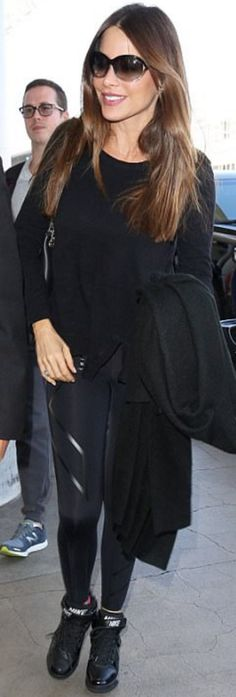 Who made  Sofía Vergara's brown sunglasses, black leggings, and wedge sneakers?