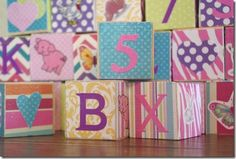 Baby shower craft: each guest decorates a block to make set of building blocks for baby