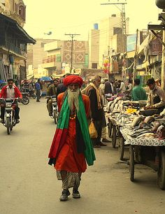 A Malang man strolling the streets of Lahore, Pakistan.