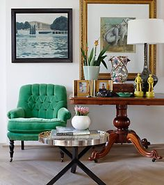 I love it all... the emerald chair, the herringbone patterned wood floor, the tables.