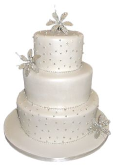 3 Tier Pearlised White Diamante Flower Wedding Cake #3tiervintageweddingcake #3tierpearlisedweddingcake #weddingcake #creamweddingcake #sparklingweddingcake #diamonteweddingcake