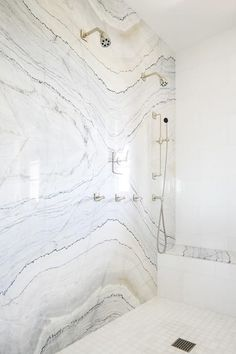 and gray marble slab shower accent wall does not need added materials to s., Cream and gray marble slab shower accent wall does not need added materials to s., Mosaic marble tiled shower ceiling The Bold Look of Slab Marble