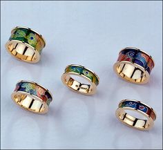 18 ct. yellow gold and enamel rings.