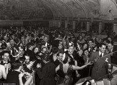 Party hats at the ready: American bandleader and singer Cab Calloway leads an orchestra during a New Year's Ball at the Cotton Club in New York in 1937