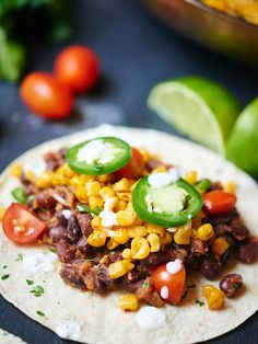 These easy vegan black bean and roasted corn tacos are so good you'll want them for Meatless Monday and Taco Tuesday! Healthy, filling, and so delicious! showmetheyummy.com #meatlessmonday #vegan #tacotuesday #vegetarian #taco #healthy #glutenfree