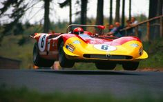 "The Alfa Romeo T33/3 of Rolf Stommelen and Piers Courage at ""Brünnchen"" I"