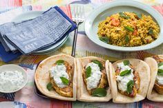 Spiced Chicken Pitas & Couscous with Carrots, Dates & Cucumber-Yogurt Sauce. Visit https://www.blueapron.com/ to receive the ingredients.