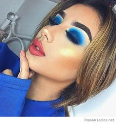 Awesome blue eye makeup, blouse and big lips
