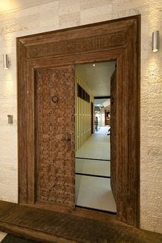 Designer - Chris VanDyke Designs, The grand entrance is a 200 years old Indian Temple door